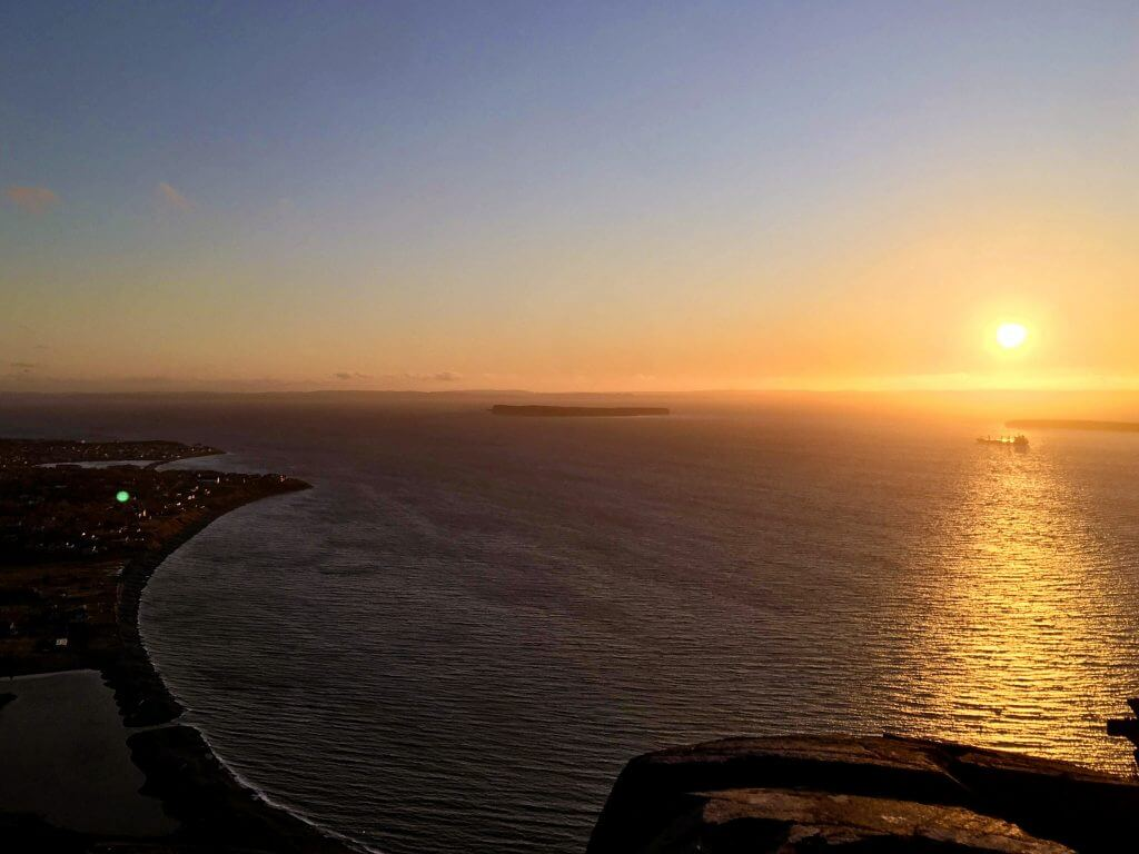 A gorgeous sunset shot out over the ocean at Topsail Bluff.