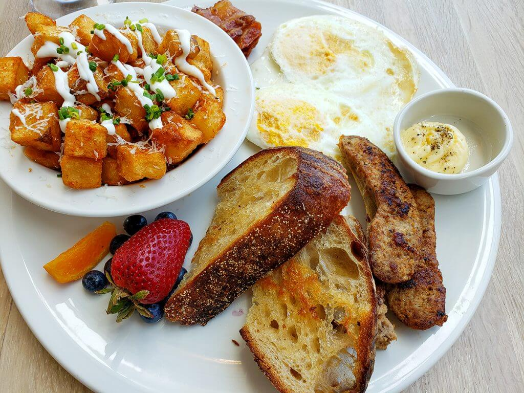 A classic brunch option beautifully plated on a white plate.